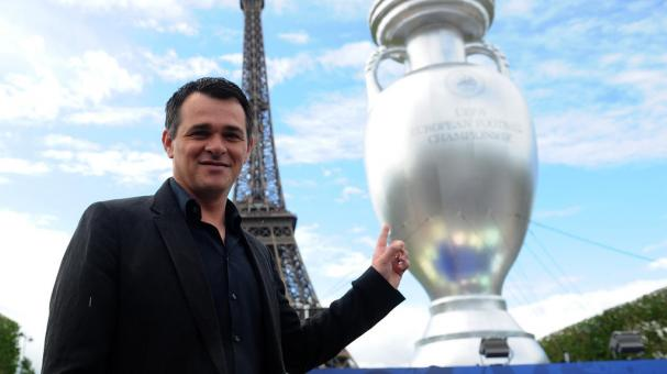 Former French football player Willy Sagnol poses next to an inflatable UEFA cup at the Champs de Mars on June 23, 2013 in Paris, France. (Photo by Antoine Antoniol/Getty Images)