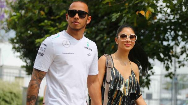 Lewis Hamilton of Great Britain and Mercedes GP and his girlfriend Nicole Scherzinger of the Pussycat Dolls arrive in the paddock before the Malaysian Formula One Grand Prix at the Sepang Circuit on March 24, 2013 in Kuala Lumpur, Malaysia. (Photo Getty)