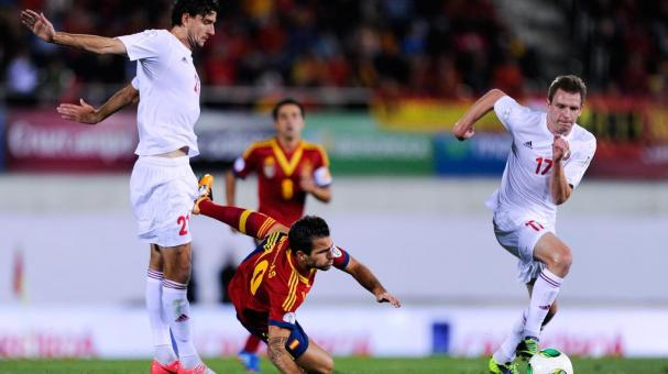 Cesc Fabregas of Spain is brought down by Filipenka of Belarus during the FIFA 2014 World Cup Qualifier match between Spain and Belarus at Iberostars Stadium on October 11, 2013 in Palma de Mallorca, Spain. (Photo by David Ramos/Getty Images)