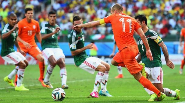 Arjen Robben of the Netherlands is tripped by Rafael Marquez of Mexico for a penalty during the 2014 FIFA World Cup Brazil Round of 16 match between Netherlands and Mexico at Castelao on June 29, 2014 in Fortaleza, Brazil. (Photo Getty Images)