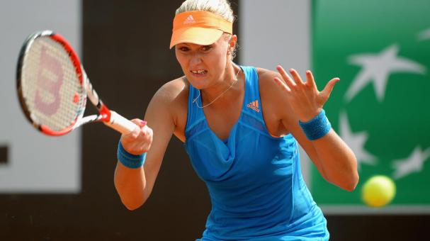 Kristina Mladenovic of France in action during her match with Monica Puig of Puerto Rico during day one of the Internazionali BNL d'Italia 2014 on May 11, 2014 in Rome, Italy. (Photo by Michael Regan/Getty Images)