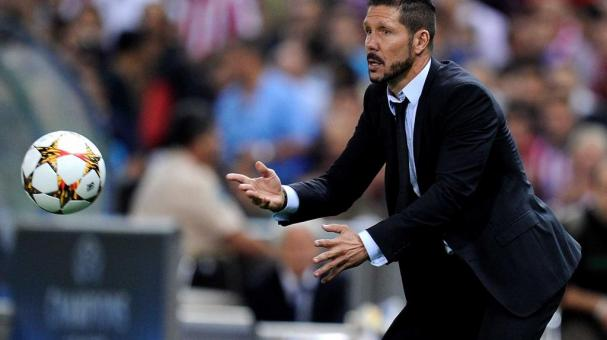 Head coach Diego Simeone of Club Atletico de Madrid throws the ball during the UEFA Champions League Group A match between Club Atletico de Madrid and Juventus at Vicente Calderon Stadium on October 1, 2014 in Madrid, Spain. (Getty Images)
