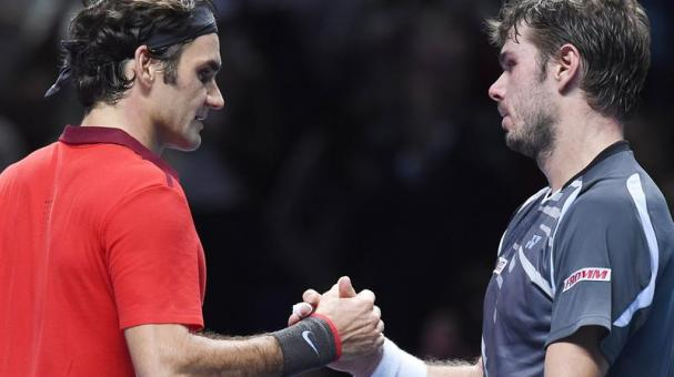 Switzerland's Roger Federer (L) shakes hands with compatriot Stanislas Wawrinka following his three set win during the ATP World Tour Finals semi-final match at the O2 Arena in London, Britain, 15 November 2014. (Tenis, Londres) EFE