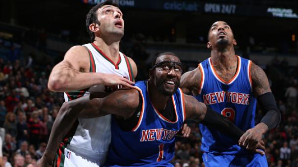 Amar'e Stoudemire #1 and J.R. Smith #8 of the New York Knicks battle for position against Zaza Pachulia #27 of the Milwaukee Bucks on November 18, 2014 in Milwaukee, Wisconsin. Getty Images