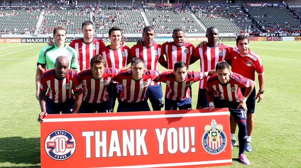 Chivas USA poses for a pregame tam photo in front of a sign thanking fans for 10 years of support. (Photo by Stephen Dunn/Getty Images)