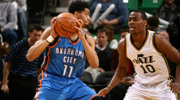 Jeremy Lamb #11 of the Oklahoma City Thunder looks on against Alec Burks #10 of the Utah Jazz at EnergySolutions Arena on November 18, 2014 in Salt Lake City, Utah. Getty Images