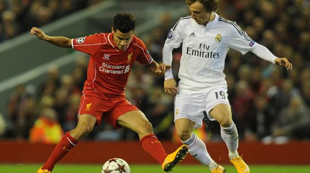Philippe Coutinho of Liverpool and Luca Modric of Real Madrid CF compete during the UEFA Champions League match between Liverpool and Real Madrid CF on October 22, 2014. Getty Images