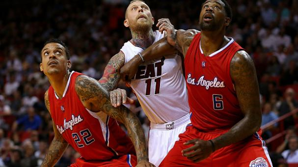 DeAndre Jordan #6 and Matt Barnes #22 of the Los Angeles Clippers box out Chris Andersen #11 of the Miami Heat during a game at American Airlines Arena on November 20, 2014 in Miami, Florida. Getty Images
