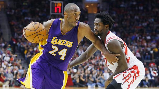 Kobe Bryant #24 of the Los Angeles Lakers drives with the ball against Patrick Beverley #2 of the Houston Rockets during their game at the Toyota Center on November 19, 2014 in Houston, Texas. (Getty Images)
