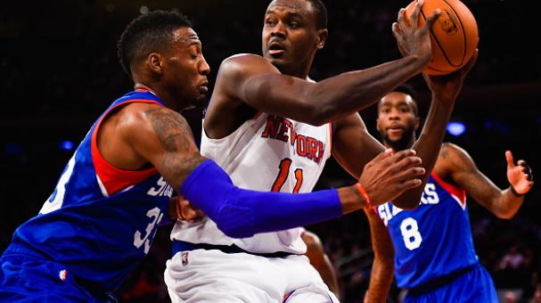 Samuel Dalembert #11 of the New York Knicks looks to pass around Robert Covington #33 of the Philadelphia 76ers in the second half at Madison Square Garden on November 22, 2014 in New York City. Getty Images