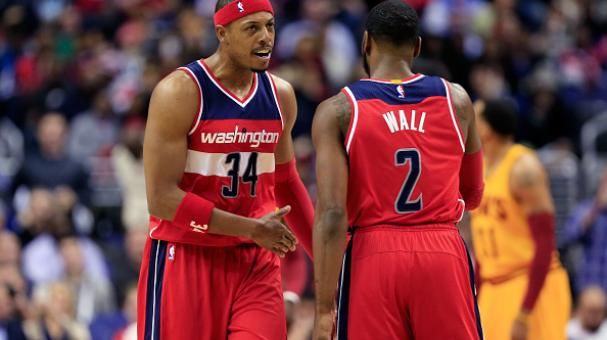 Paul Pierce #34 of the Washington Wizards and John Wall #2 talk during the first half against the Cleveland Cavaliers at Verizon Center on November 21, 2014 in Washington, DD. Getty Images
