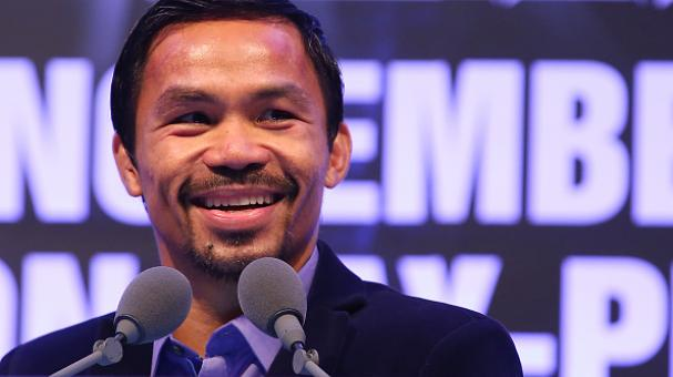 Manny Pacquiao of the Philippines speaks to media at the post fight press conference after winning against Chris Algieri of the United States during the WBO world welterweight title at The Venetian on November 23, 2014 in Macau, Macau. (Getty Images)