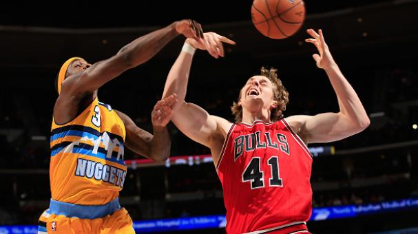 Ty Lawson #3 of the Denver Nuggets and Cameron Bairstow #41 of the Chicago Bulls battle for a rebound at Pepsi Center on November 25, 2014 in Denver, Colorado. Getty Images