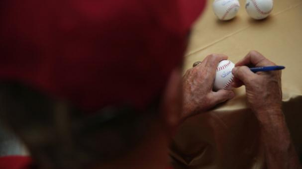Former Major League Baseball pitcher and Hall of Fame inductee Steve Carlton signs autographs on baseballs. July 23, 2014 on Capitol Hill in Washington, DC. Photo by Alex Wong/Getty Images