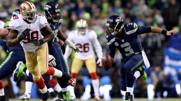Quarterback Russell Wilson #3 of the Seattle Seahawks is pressured by outside linebacker Aldon Smith #99 of the San Francisco 49ers . (Photo by Christian Petersen/Getty Images)