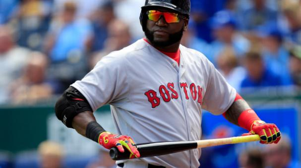 David Ortiz #34 of the Boston Red Sox looks back as he walks off the field after striking out duringon September 14, 2014 in Kansas City, Missouri. (Photo by Jamie Squire/Getty Images)