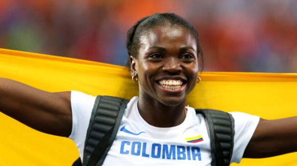 Caterine Ibarguen of Colombia celebrates winning gold medal. (Photo by Julian Finney/Getty Images)