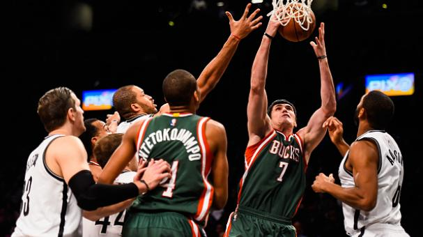 Ersan Ilyasova #7 of the Milwaukee Bucks grabs a rebound over Alan Anderson #6 of the Brooklyn Nets in the first half at the Barclays Center on November 19, 2014 in the Brooklyn borough of New York City. Getty Images