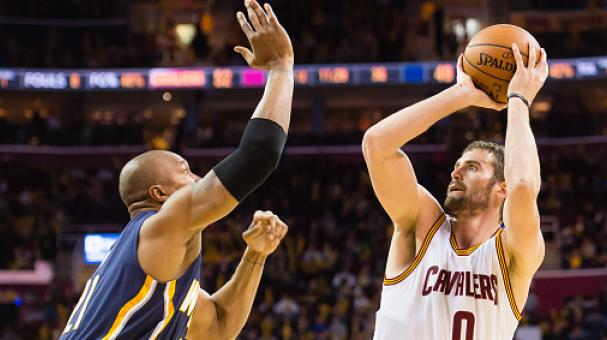 David West #21 of the Indiana Pacers tries to block Kevin Love #0 of the Cleveland Cavaliers during the second half at Quicken Loans Arena on November 29, 2014 in Cleveland, Ohio. Getty Images