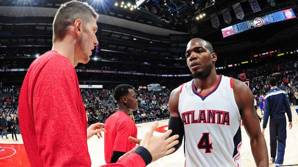 Mike Muscala #31 and Paul Millsap #4 of the Atlanta Hawks celebrate after the game against the Detroit Pistons on November 21, 2014 at Philips Arena in Atlanta, Georgia. Getty Images