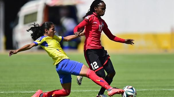 Trinidad and Tobagos Ahkcola Mollar(R) vies for the ball with Ecuadors Ingrid Rodriguez during their play-off match for the FIFA Women's World Cup Canada 2015. Getty Images