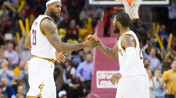 LeBron James #23 and Kyrie Irving #2 of the Cleveland Cavaliers celebrate after James scored during the second half against the Milwaukee Bucks at Quicken Loans Arena on December 2, 2014 in Cleveland, Ohio. Getty Images