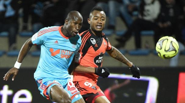 Lorient's Ghanaian striker Jordan Ayew (R) vies with Marseille's French defender Rod Fanni during the French L1 football match Lorient against Marseille on December 2, 2014. Getty Images