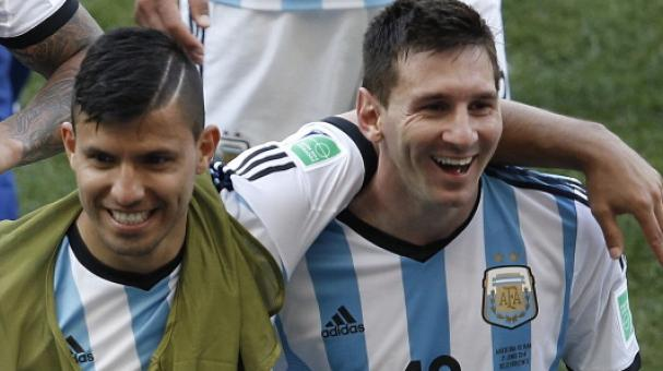 Argentina's forward and captain Lionel Messi (R) celebrates with Argentina's forward Sergio Aguero after the Group F football match between Argentina and Iran at the Mineirao Stadium in Belo Horizonte. Getty Images