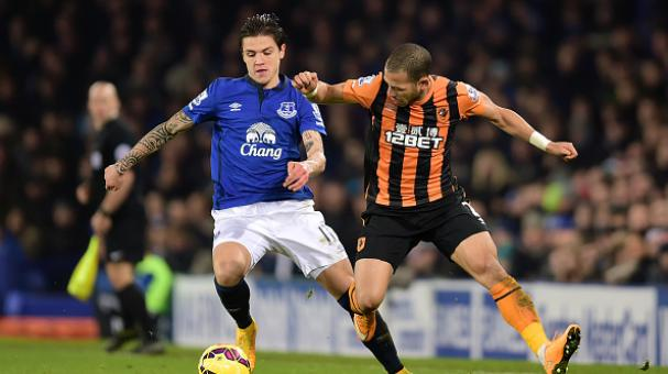 Muhamed Besic of Everton is challenged by Liam Rosenior of Hull City during the Barclays Premier League match between Everton and Hull City at Goodison Park on December 3, 2014 in Liverpool, England. (Photo by Jamie McDonald/Getty Images)