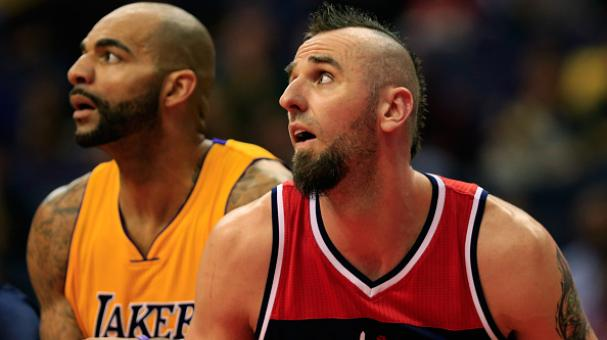 Carlos Boozer #5 of the Los Angeles Lakers (L) and Marcin Gortat #4 of the Washington Wizards follow a free throw shot during the first half at Verizon Center in Washington, DC. Getty Images