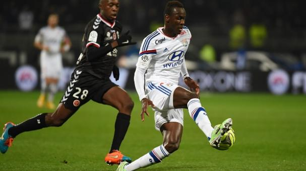 Lyon's  Mohamed Yattara (R) vies for the ball with Reims'  Antoine Conte (L) during the French League football match Olympique Lyonnais against Stade de Reims on December 4, 2014 at the Gerland stadium in Lyon. Getty Images