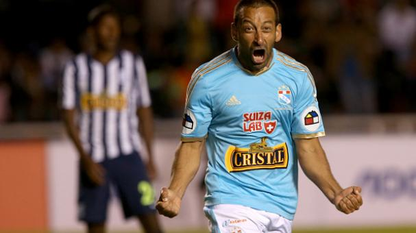 Sergio Blanco of Sporting Cristal celebrates the first goal of his team against Alianza Lima during a final match between Alianza Lima and Sporting Cristal as part of Torneo Clausura 2014. Getty Images