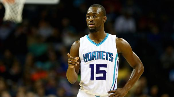 Kemba Walker #15 of the Charlotte Hornets points to the bench during their game against the Portland Trail Blazers at Time Warner Cable Arena on November 26, 2014 in Charlotte, North Carolina. Getty Images