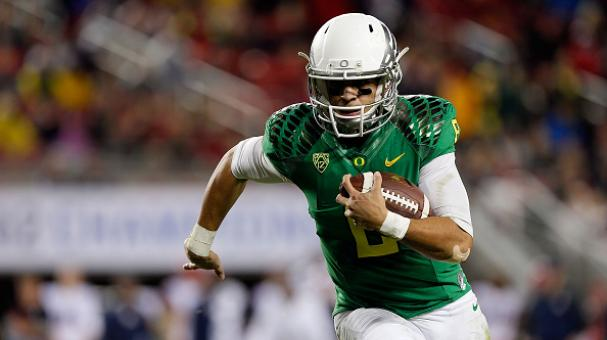 Marcus Mariota #8 of the Oregon Ducks scrambles in the first half against the Arizona Wildcats during the PAC-12 Championships at Levi's Stadium on December 5, 2014 in Santa Clara, California. (Getty Images)