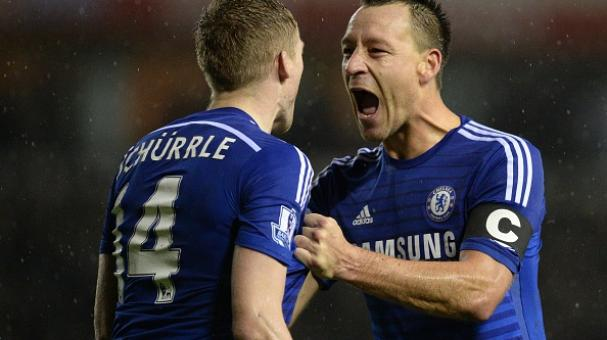 Chelsea's John Terry (R) congratulates Andre Schurrle on scoring their third goal during the English League Cup quarter-final football match between Derby County and Chelsea at iPro Stadium on December 16, 2014. Getty Images