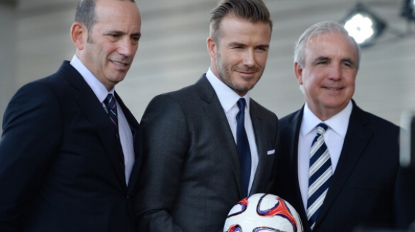 Commissioner Don Garber, David Beckham and Mayor Carlos Gimenez attend a press conference to announce their plans to launch a new Major League Soccer franchise at PAMM Art Museum on February 5, 2014 in Miami, Florida. (Photo by Larry Marano/Getty Images)
