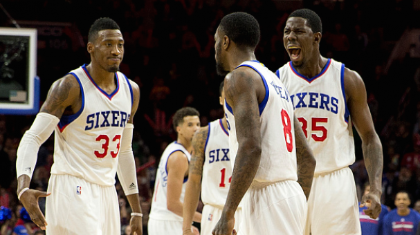 Robert Covington #33, Tony Wroten #8, and Henry Sims #35 of the Philadelphia 76ers react after a made basket at the Wells Fargo Center in Philadelphia, Pennsylvania. Getty Images