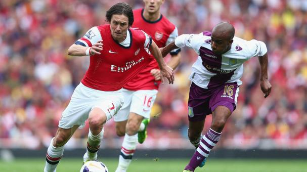 Thomas Rosicky of Arsenal is challenged by Fabian Delph of Aston Villa during the Barclays Premier League match between Arsenal and Aston Villa at Emirates Stadium on August 17, 2013 in London, England. (Getty Images)