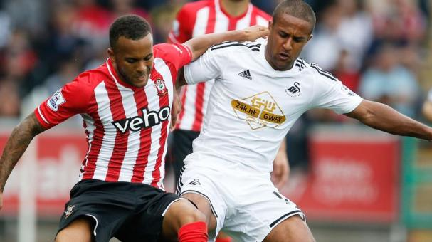 Ryan Bertrand of Southampton is challenged by Wayne Routledge of Swansea City during the Barclays Premier League match between Swansea City and Southampton at Liberty Stadium on September 20, 2014 in Swansea, Wales. (Getty Images)