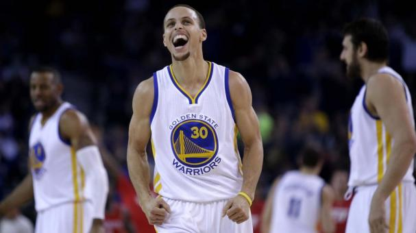 Stephen Curry #30 of the Golden State Warriors reacts after he stole the ball and then made a basket in the first half of their game against the Houston Rockets at ORACLE Arena in Oakland, California. Getty Images