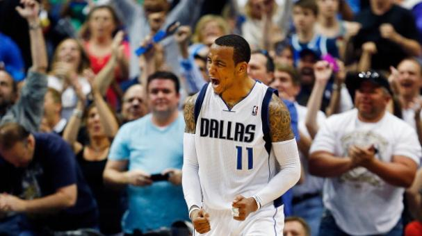 Monta Ellis #11 of the Dallas Mavericks reacts after scoring at American Airlines Center in Dallas, Texas. (Photo by Tom Pennington/Getty Images)