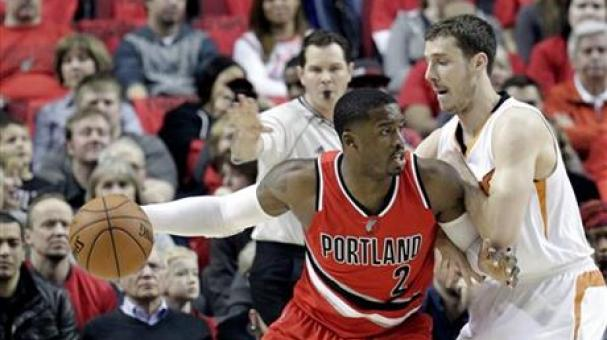Portland Trail Blazers guard Wesley Matthews, left, works the ball in against Phoenix Suns guard Goran Dragic, from Slovenia, during the first half of an NBA basketball game in Portland. AP
