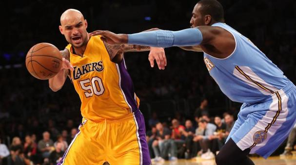 Robert Sacre #50 of the Los Angeles Lakers drives against J.J. Hickson #7 of the Denver Nuggets at Staples Center on February 10, 2015 in Los Angeles, California. Getty Images