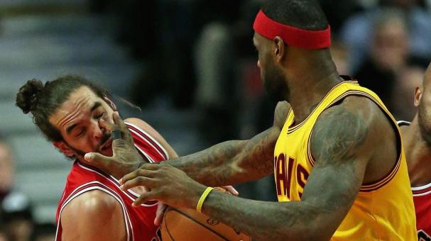 LeBron James #23 of the Cleveland Cavaliers fouls Joakim Noah #13 of the Chicago Bulls at the United Center on February 12, 2015 in Chicago, Illinois. Getty Images