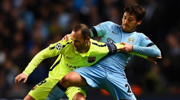 Andres Iniesta of Barcelona holds off David Silva of Manchester City during the UEFA Champions League Round of 16 match between Manchester City and Barcelona at Etihad Stadium on February 24, 2015 in Manchester, United Kingdom. Getty Images