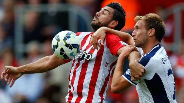 Steven Davis of Southampton and Craig Gardner of West Brom compete for the ball during the Barclays Premier League match between Southampton and West Bromwich Albion at St Mary's Stadium on August 23, 2014 in Southampton, England. (Getty Images)