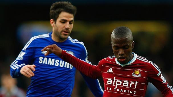 Cesc Fabregas of Chelsea marshalls Enner Valencia of West Ham during the Barclays Premier League match between Chelsea and West Ham United at Stamford Bridge on December 26, 2014 in London, England. (Getty Images)