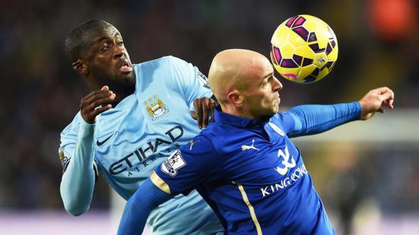 Yaya Toure of Manchester City and Esteban Cambiasso of Leicester City at The King Power Stadium on December 13, 2014 in Leicester, England. (Getty Images)