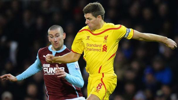 Steven Gerrard of Liverpool is closed down by David Jones of Burnley during the Barclays Premier League match between Burnley and Liverpool at Turf Moor on December 26, 2014 in Burnley, England. (Photo by Tony Marshall/Getty Images)