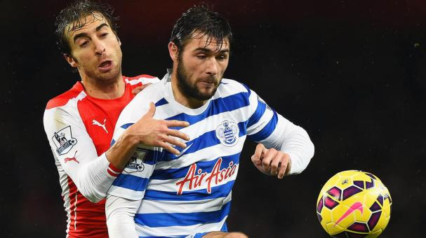 Charlie Austin of QPR is challenged by Mathieu Flamini of Arsenal during the Barclays Premier League at Emirates Stadium on December 26, 2014 in London, England. (Getty Images)